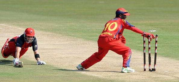 PRETORIA, SOUTH AFRICA - SEPTEMBER 12: Callum Ferguson of South Australian Redbacks is run out by Thami Tsolekile of Highveld Lions during the Airtel Champions League Twenty20 match between  Highveld Lions and South Australian Redbacks at SuperSport Park on September 12, 2010 in Pretoria, South Africa (Photo by Lee Warren/Gallo Images/Getty Images)