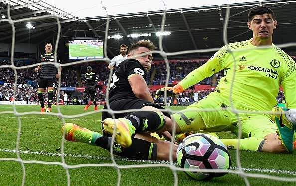 SWANSEA, WALES - SEPTEMBER 11:  Chelsea goalkeeper Thibaut Courtois and Gary Cahill (r) fail to stop the second Swansea goal scored by Leroy Fer (not pictured) during the Premier League match between Swansea City and Chelsea at Liberty Stadium on September 11, 2016 in Swansea, Wales.  (Photo by Stu Forster/Getty Images)