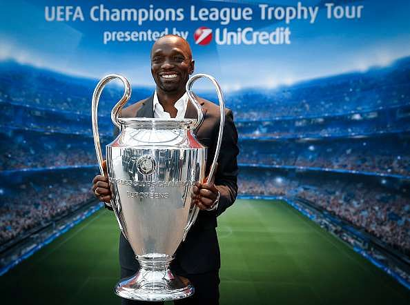 BUCHAREST, ROMANIA - SEPTEMBER 16: Claude Makelele poses with the UEFA Champions League Trophy during the UEFA Champions League Trophy Tour - by UniCredit press conference at UniCredit headquarter on September 16, 2016 in Bucharest, Romania. (Photo by Srdjan Stevanovic/Getty Images)