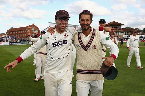 SOMERSET, UNITED KINGDOM - SEPTEMBER 22:  Jack Leach (L)) and Peter Trego (R) of Somerset during a lap of honour concluding their sides 325 run victory during day three of the Specsavers County Championship Division One match between Somerset and Nottinghamshire at The Cooper Associates County Ground on September 22, 2016 in Somerset, United Kingdom.  (Photo by Michael Steele/Getty Images)