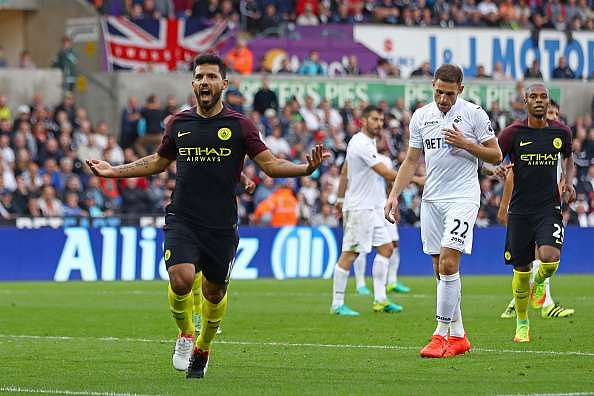 SWANSEA, WALES - SEPTEMBER 24:  Sergio Aguero of Manchester City celebrates scoring his sides second goal  during the Premier League match between Swansea City and Manchester City at the Liberty Stadium on September 24, 2016 in Swansea, Wales.  (Photo by Michael Steele/Getty Images)