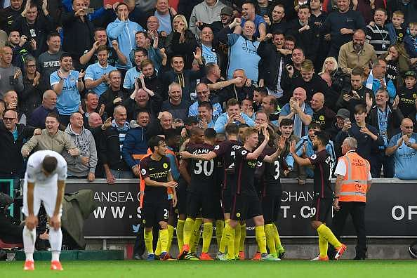 SWANSEA, WALES - SEPTEMBER 24: Raheem Sterling of Manchester City scores his sides third goal during the Premier League match between Swansea City and Manchester City at the Liberty Stadium on September 24, 2016 in Swansea, Wales.  (Photo by Stu Forster/Getty Images)
