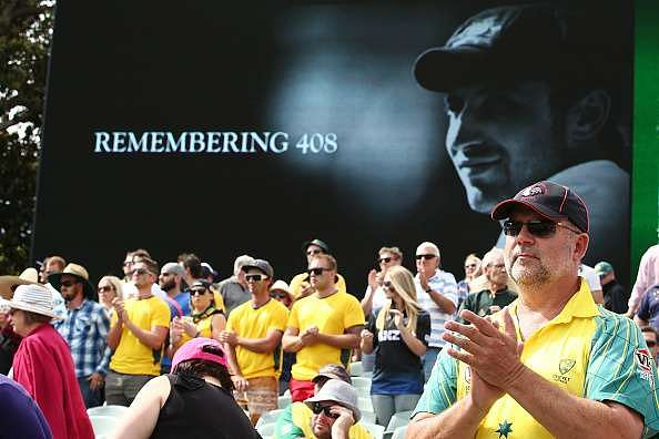 ADELAIDE, AUSTRALIA - NOVEMBER 27:  Spectators pay tribute to former cricketer Phillip Hughes at eight minutes past four during day one of the Third Test match between Australia and New Zealand at Adelaide Oval on November 27, 2015 in Adelaide, Australia.  (Photo by Morne de Klerk/Getty Images)