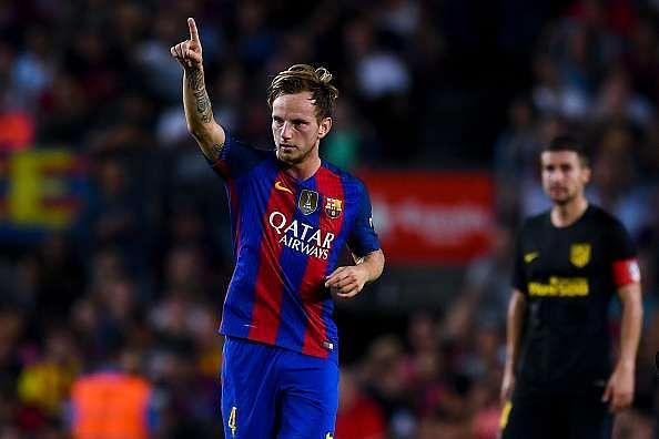 BARCELONA, SPAIN - SEPTEMBER 21:  Ivan Rakitic of FC Barcelona celebrates after scoring his team
