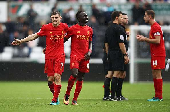 SWANSEA, WALES - OCTOBER 01: James Milner of Liverpool (L) and Sadio Mane of Liverpool (LC) celebrate after Liverpool win during the Premier League match between Swansea City and Liverpool at Liberty Stadium on October 1, 2016 in Swansea, Wales.  (Photo by Julian Finney/Getty Images)