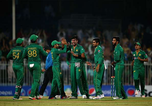 SHARJAH, UNITED ARAB EMIRATES - OCTOBER 02:  Muhammed Amir of Pakistan celebrates with teammates after dismissing Johnson Charles of West Indies  during the second One Day International match between Pakistan and West Indies  at Sharjah Cricket Stadium on October 2, 2016 in Sharjah, United Arab Emirates.  (Photo by Francois Nel/Getty Images)