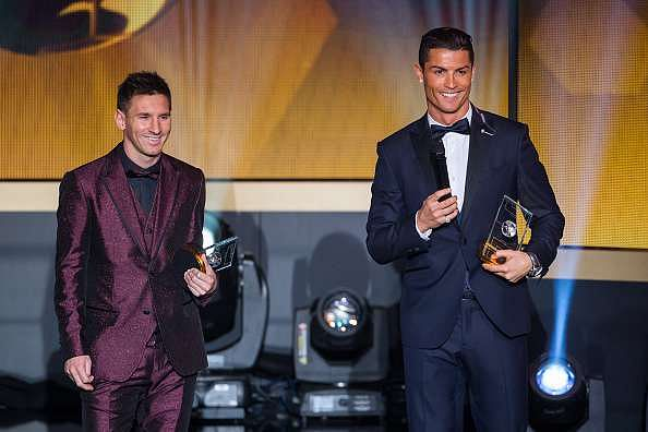 ZURICH, SWITZERLAND - JANUARY 12: FIFA Ballon d'Or nominees Lionel Messi of Argentina and FC Barcelona  (L) and Cristiano Ronaldo of Portugal and Real Madrid smile during the FIFA Ballon d'Or Gala 2014 at the Kongresshaus on January 12, 2015 in Zurich, Switzerland. (Photo by Philipp Schmidli/Getty Images)
