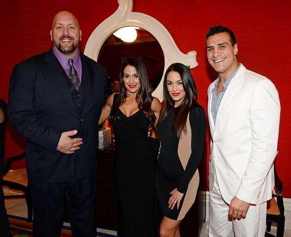 Big Show, pictured with Brie and Nikki Bella and Alberto Del Rio