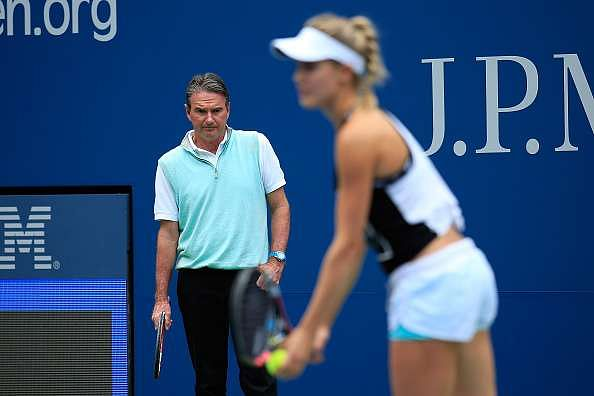 NEW YORK, NY - AUGUST 30:  Jimmy Connors coaches Eugenie Bouchard of Canada during a practice session prior to the U.S. Open at USTA Billie Jean King National Tennis Center on August 30, 2015 in New York City.  (Photo by Chris Trotman/Getty Images for the USTA)