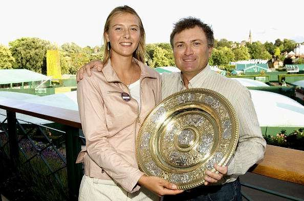LONDON - JULY 3: Maria Sharapova of Russia, winner of the ladies singles finals, poses for a picture with her father, Yuri Sharapova as she holds the winning trophy on the