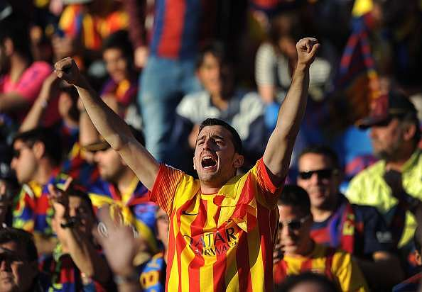 MADRID, SPAIN - MAY 22:  A Barcelona fan cheers for his team ahead of the Copa del Rey Final between Barcelona and Sevilla at Vicente Calderon Stadium on May 22, 2016 in Madrid, Spain.  (Photo by Denis Doyle/Getty Images)