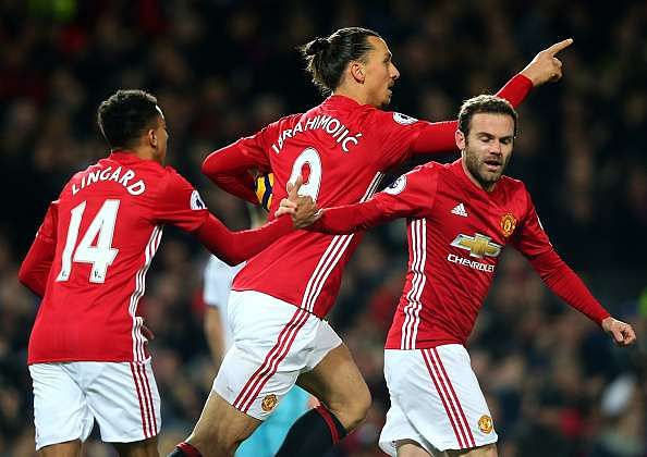 MANCHESTER, ENGLAND - NOVEMBER 27:  Zlatan Ibrahimovic of Manchester United (L) celebrates scoring his sides first goal with Juan Mata of Manchester United (R) during the Premier League match between Manchester United and West Ham United at Old Trafford on November 27, 2016 in Manchester, England.  (Photo by Alex Livesey/Getty Images)