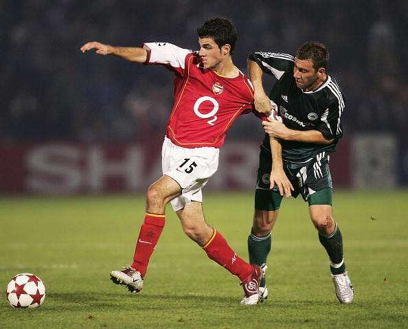 ATHENS, GREECE - OCTOBER 20:  Francesc Fabregas of Arsenal is challenged by Dumitru Mitu of Panathinaikos during the UEFA Champions League Group E match between Panathinaikos and Arsenal at the Apostolos Nikolaidis Stadium on October 20, 2004 in Athens, Greece.  (Photo by Shaun Botterill/Getty Images)