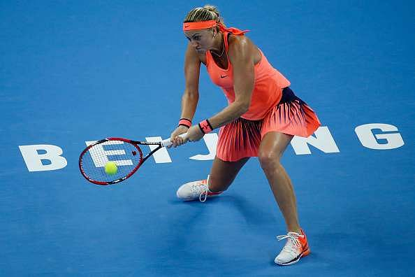 BEIJING, CHINA - OCTOBER 07:  Petra Kvitova of the Czech Republic returns a shot against Madison Keys of the United States during her Women