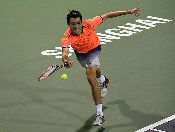 SHANGHAI, CHINA - OCTOBER 12:  Taylor Fritz of United States returns a shot to Roberto Bautista Agut of Spain in the Men's Singles Second Round match during Day 4 of the ATP Shanghai Rolex Masters 2016 at Qi Zhong Tennis Centre on October 12, 2016 in Shanghai, China.  (Photo by Kevin Lee/Getty Images)