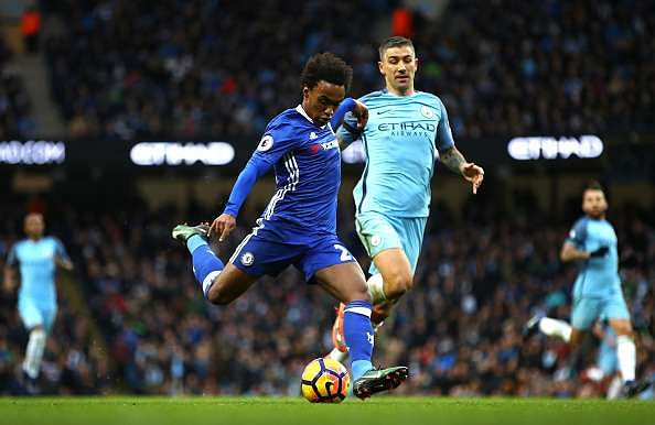 MANCHESTER, ENGLAND - DECEMBER 03:  Willian of Chelsea scores his team