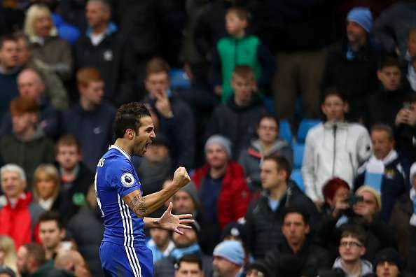 MANCHESTER, ENGLAND - DECEMBER 03:  Cesc Fabregas of Chelsea celebrates his team