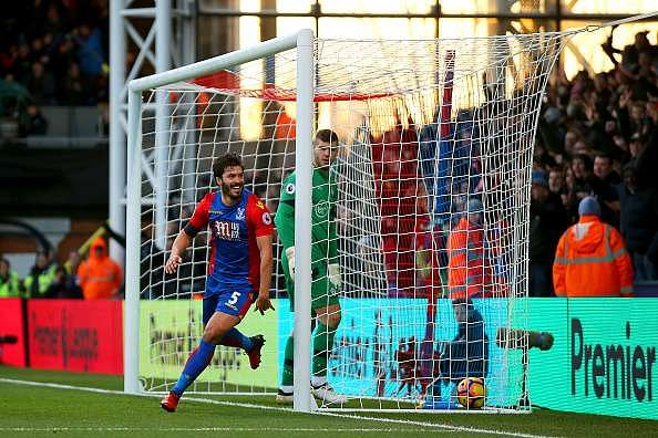 LONDON, ENGLAND - DECEMBER 03:  James Tomkins of Crystal Palace celebrates scoring his team