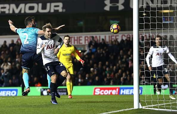 LONDON, ENGLAND - DECEMBER 03:  Christian Eriksen (2nd R) of Tottenham Hotspur scores his team