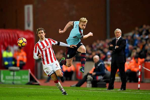STOKE ON TRENT, ENGLAND - DECEMBER 03:  Ben Mee of Burnley and Marc Muniesa of Stoke City compete for the ball during the Premier League match between Stoke City and Burnley at Bet365 Stadium on December 3, 2016 in Stoke on Trent, England.  (Photo by Gareth Copley/Getty Images)