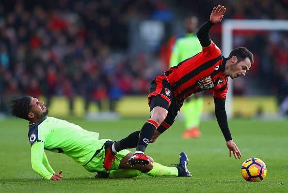 BOURNEMOUTH, ENGLAND - DECEMBER 04:  Adam Smith of AFC Bournemouth is tackled by Emre Can of Liverpool during the Premier League match between AFC Bournemouth and Liverpool at Vitality Stadium on December 4, 2016 in Bournemouth, England.  (Photo by Michael Steele/Getty Images)