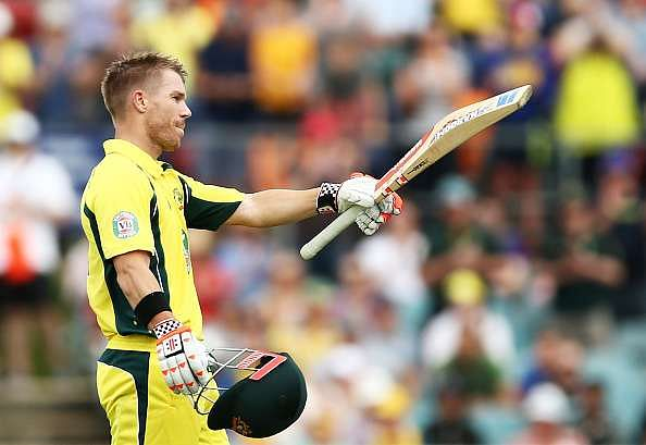 CANBERRA, AUSTRALIA - DECEMBER 06:  David Warner of Australia celebrates and acknowledges the crowd after scoring a century during game two of the One Day International series between Australia and New Zealand at Manuka Oval on December 6, 2016 in Canberra, Australia.  (Photo by Mark Metcalfe/Getty Images)