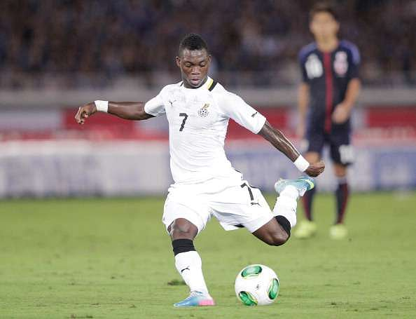 YOKOHAMA, JAPAN - SEPTEMBER 10:  Christian Atsu of Ghana in action during the international friendly match between Japan and Ghana at International Stadium Yokohama on September 10, 2013 in Yokohama, Japan.  (Photo by Adam Pretty/Getty Images)