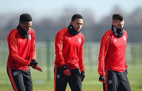 MANCHESTER, ENGLAND - FEBRUARY 24:  (L-R) Anthony Martial, Memphis Depay and Morgan Schneiderlin look on during a Manchester United training session ahead of their UEFA Europa League round of 32 second leg match against FC Midtjylland at the Aon Training Complex on February 24, 2016 in Manchester, United Kingdom.  (Photo by Jan Kruger/Getty Images)