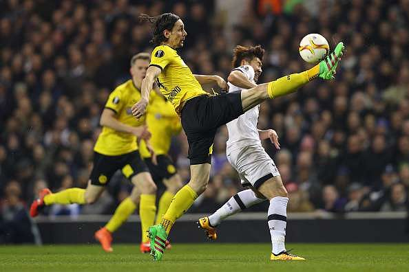 LONDON, ENGLAND - MARCH 17:  Neven Subotic of Borussia Dortmund clears the ball from Son Heung-min of Tottenham Hotspur during the UEFA Europa League round of 16, second leg match between Tottenham Hotspur and Borussia Dortmund at White Hart Lane on March 17, 2016 in London, England.  (Photo by Paul Gilham/Getty Images)
