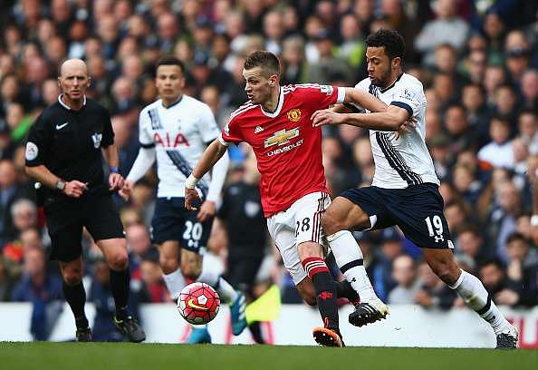 LONDON, ENGLAND - APRIL 10:  Morgan Schneiderlin of Manchester United holds off Mousa Dembele of Tottenham Hotspur during the Barclays Premier League match between Tottenham Hotspur and Manchester United at White Hart Lane on April 10, 2016 in London, England.  (Photo by Ian Walton/Getty Images)