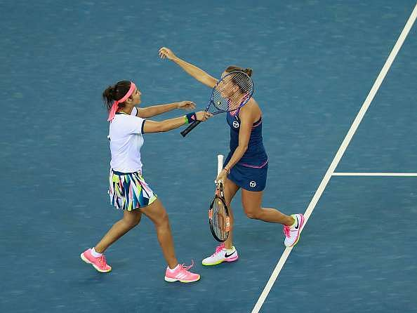 WUHAN, CHINA - SEPTEMBER 30:  Sania Mirza and Barbora Strycova of Czech Republic celebrate after winning the semi-final match against Hao-Ching Chan of Chinese Taipei and Yung-Jan Chan of Chinese Taipei on day 6 at Optics Valley International Tennis Center on September 30, 2016 in Wuhan, China.  (Photo by Kevin Lee/Getty Images)