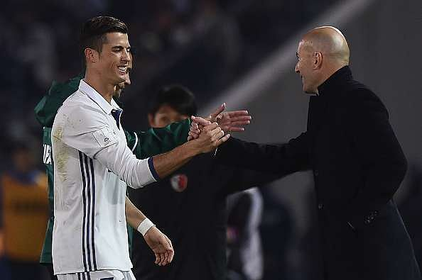 YOKOHAMA, JAPAN - DECEMBER 18:  Cristiano Ronaldo of Real Madrid shakes hands with Real Madrid coach Zinedine Zidane during the FIFA Club World Cup final match between Real Madrid and Kashima Antlers at International Stadium Yokohama on December 18, 2016 in Yokohama, Japan.  (Photo by Matt Roberts/Getty Images)