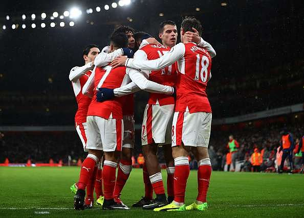 LONDON, ENGLAND - JANUARY 01:  Alex Iwobi (obscured) of Arsenal celebrates with teammates after scoring his team