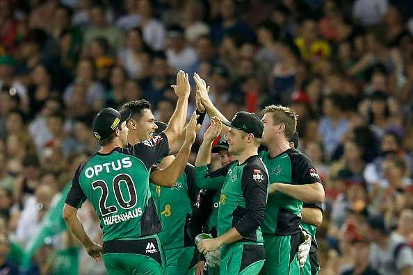 MELBOURNE, AUSTRALIA - JANUARY 07:  Scott Boland of the Melbourne Stars celebrates with team mates after taking the wicket of Aaron Finch of the Melbourne Renegades during the Big Bash League match between the Melbourne Renegades and the Melbourne Stars at Etihad Stadium on January 7, 2017 in Melbourne, Australia.  (Photo by Darrian Traynor/Getty Images)
