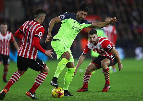 SOUTHAMPTON, ENGLAND - JANUARY 11:  Emre Can of Liverpool is watched by Dusan Tadic (11) and Jay Rodriguez of Southampton (9) during the EFL Cup semi-final first leg match between Southampton and Liverpool at St Mary