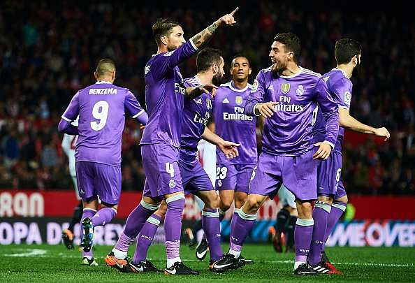 SEVILLE, SPAIN - JANUARY 12:  MSergio Ramos of Real Madrid CF celebrates after scoring the second goal of Real Madrid CF with his team mates during the Copa del Rey Round of 16 Second Leg match between Sevilla FC vs Real Madrid CF at Ramon Sanchez Pizjuan stadium on January 12, 2017 in Seville, Spain.  (Photo by Aitor Alcalde/Getty Images)