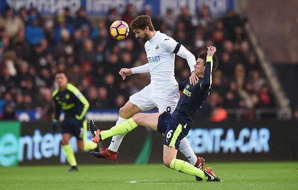 SWANSEA, WALES - JANUARY 14: Fernando Llorente of Swansea City heads the ball while Laurent Koscielny of Arsenal (R) attempts to tackle him during the Premier League match between Swansea City and Arsenal at Liberty Stadium on January 14, 2017 in Swansea, Wales.  (Photo by Tony Marshall/Getty Images)