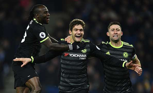 LEICESTER, ENGLAND - JANUARY 14:  Marcos Alonso (C) of Chelsea celebrates with teammates Victor Moses (L) and Gary Cahill (R) after scoring his team