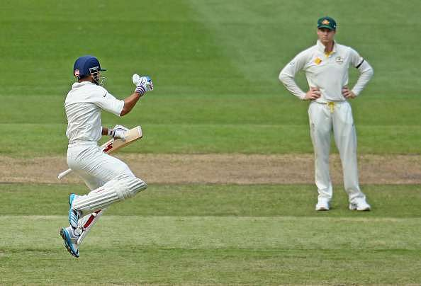 MELBOURNE, AUSTRALIA - DECEMBER 28:  Virat Kohli (L) of India leaps as he celebrates after reaching his century as Steven Smith of Australia looks on during day three of the Third Test match between Australia and India at Melbourne Cricket Ground on December 28, 2014 in Melbourne, Australia.  (Photo by Scott Barbour/Getty Images)