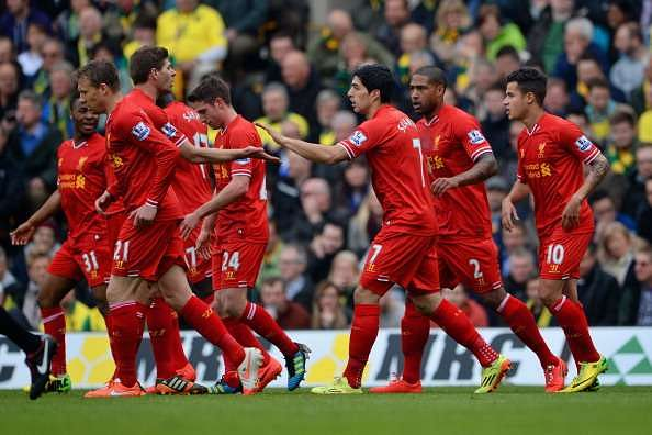 NORWICH, ENGLAND - APRIL 20: Steven Gerrard of Liverpool congratulates Luis Suarez of Liverpool on scoring their second goal during the Barclays Premier League match between Norwich City and Liverpool at Carrow Road on April 20, 2014 in Norwich, England.  (Photo by Michael Regan/Getty Images)