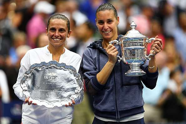 NEW YORK, NY - SEPTEMBER 12:  Flavia Pennetta (R) of Italy and Roberta Vinci (L) of Italy pose with their trophies after their Women