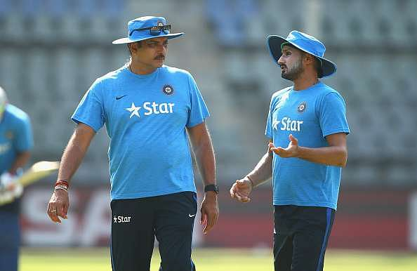 MUMBAI, INDIA - MARCH 30:  Ravi Shastri, Head Coach of India speaks with Harbhajan Singh of India during an India training session at Wankhede Stadium on March 30, 2016 in Mumbai, India.  (Photo by Ryan Pierse/Getty Images)