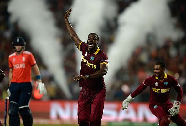 KOLKATA, WEST BENGAL - APRIL 03:  Carlos Brathwaite of the West Indies celebrates dismissing Joe Root of England during the ICC World Twenty20 India 2016 Final between England and the West Indies at Eden Gardens on April 3, 2016 in Kolkata, India.  (Photo by Gareth Copley/Getty Images)