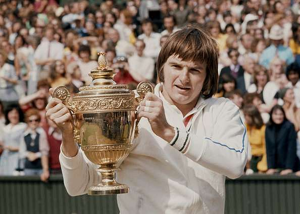Jimmy Connors of the United States holds the trophy at winning the Men