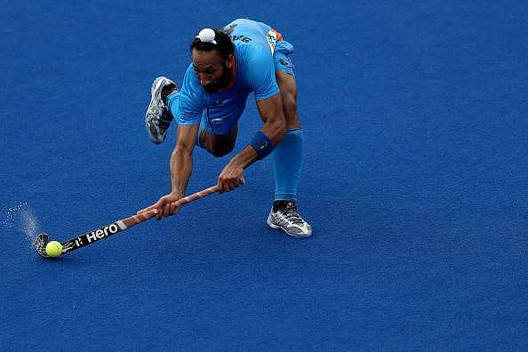 RIO DE JANEIRO, BRAZIL - AUGUST 08:  Sardar Singh #8 of India passes the ball against Germany during a Men