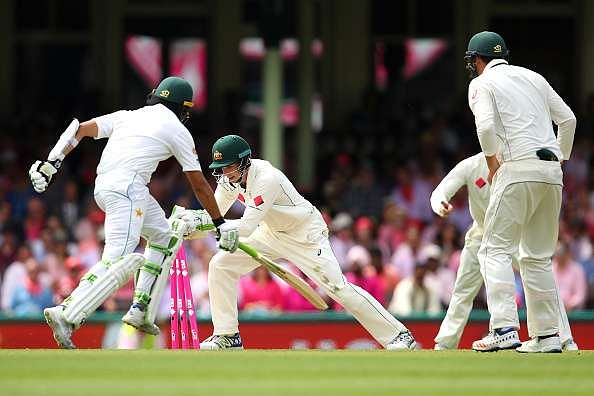 Azhar Ali is dismissed with his bat in the air while trying to complete a run