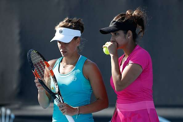 MELBOURNE, AUSTRALIA - JANUARY 18:  Sania Mirza of India and Barbora Strycova of the Czech Republic  compete in their first round match against Joclyn Rae of Great Britain and Anna Smith of Great Britain on day three of the 2017 Australian Open at Melbourne Park on January 18, 2017 in Melbourne, Australia.  (Photo by Jack Thomas/Getty Images)