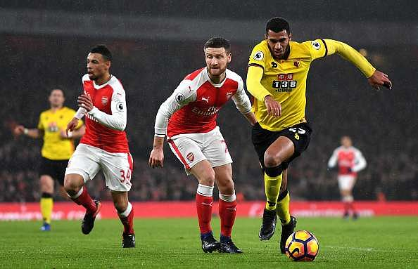 LONDON, ENGLAND - JANUARY 31: Etienne Capoue of Watford goes past Shkodran Mustafi of Arsenal during the Premier League match between Arsenal and Watford at Emirates Stadium on January 31, 2017 in London, England.  (Photo by Mike Hewitt/Getty Images)