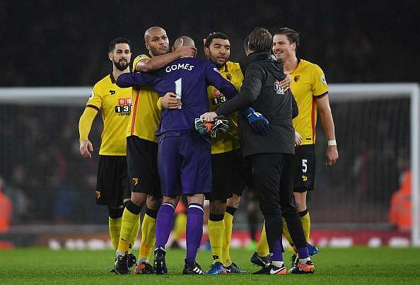 LONDON, ENGLAND - JANUARY 31:  Watford players celebrate their 2-1 win in the Premier League match between Arsenal and Watford at Emirates Stadium on January 31, 2017 in London, England.  (Photo by Mike Hewitt/Getty Images)
