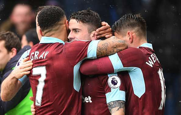 BURNLEY, ENGLAND - FEBRUARY 12:  Robbie Brady of Burnley celebrates scoring his sides first goal with team mates during the Premier League match between Burnley and Chelsea at Turf Moor on February 12, 2017 in Burnley, England.  (Photo by Mike Hewitt/Getty Images)
